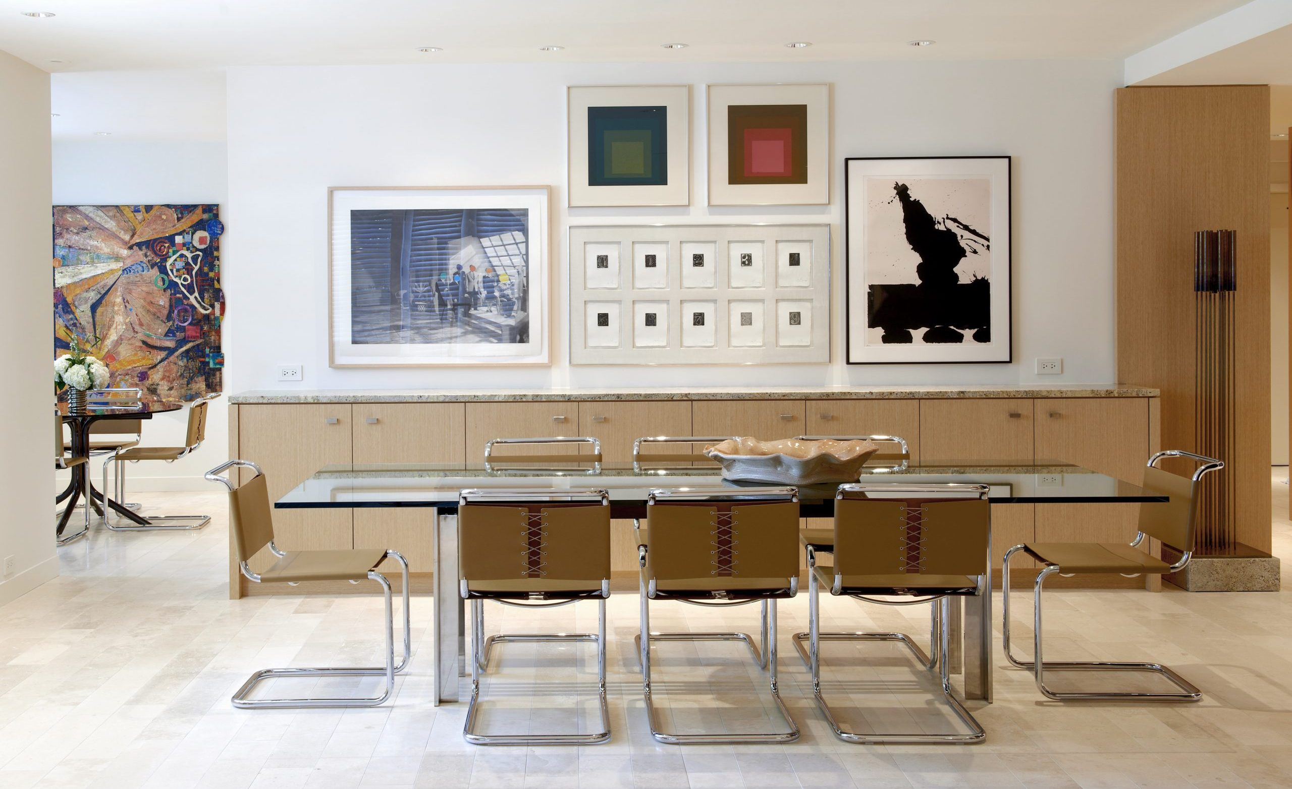 Dining room with glass table and Breuer chairs