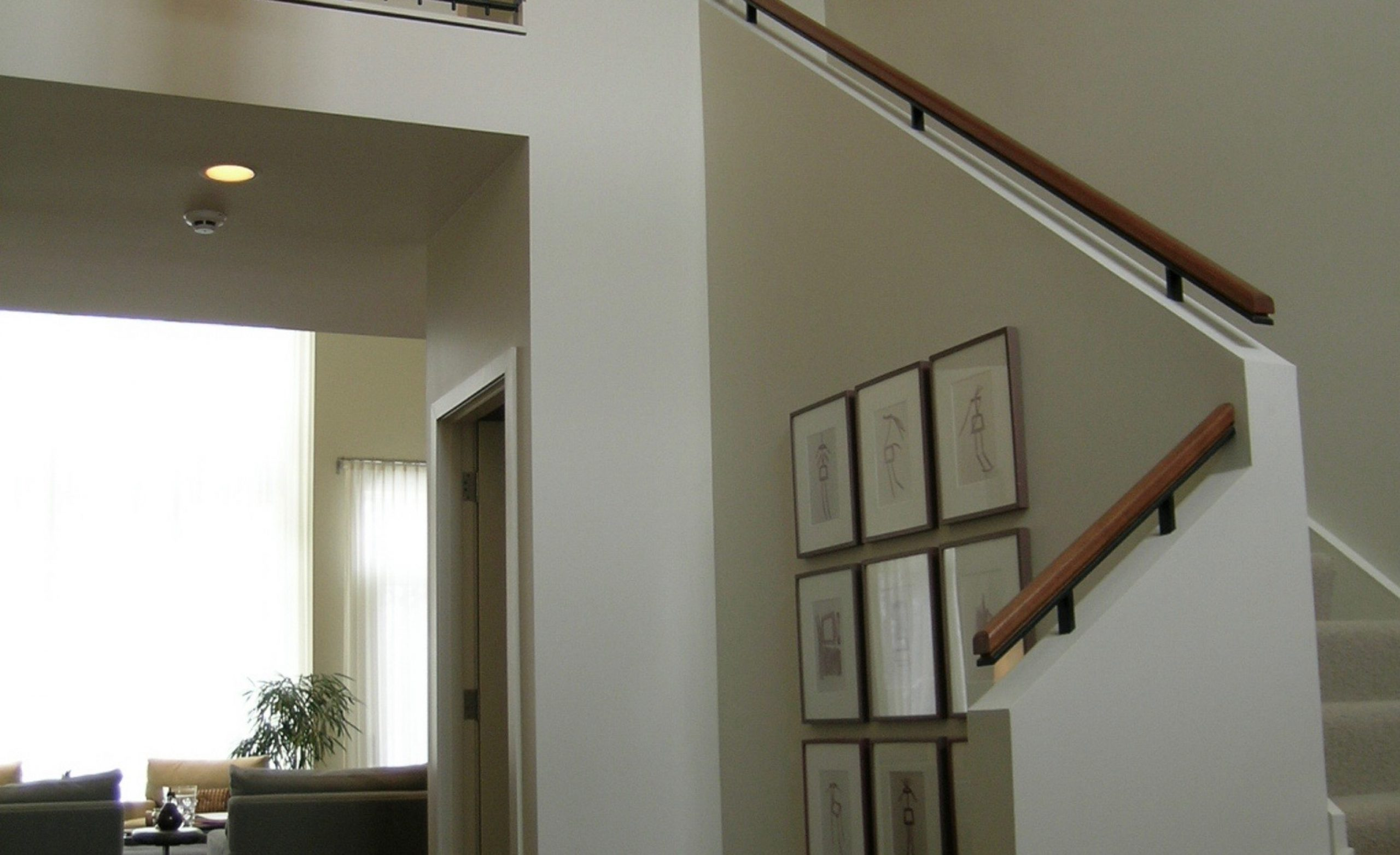 Entryway with staircase and views to living area