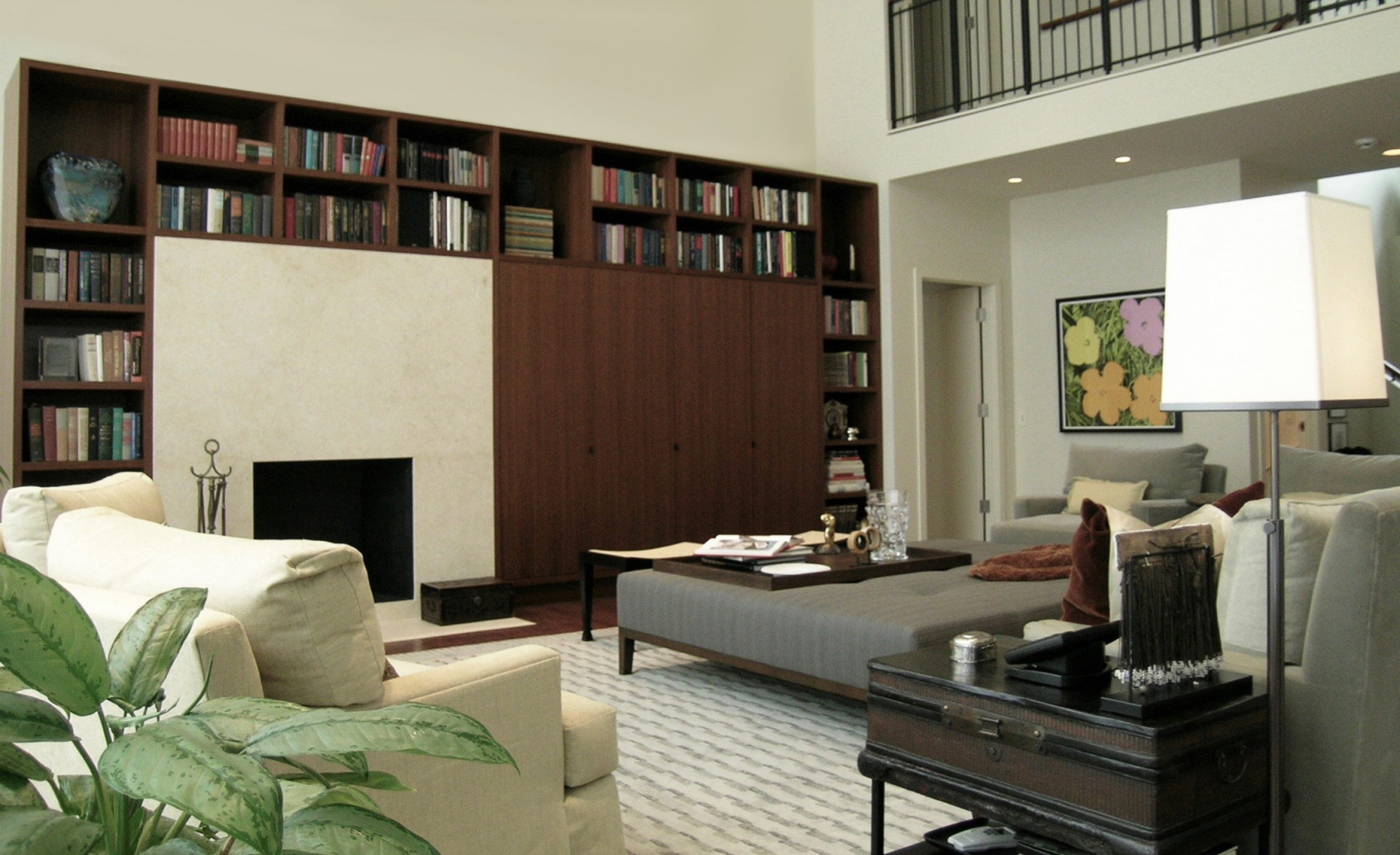Great room with fireplace and built-in bookcase and storage
