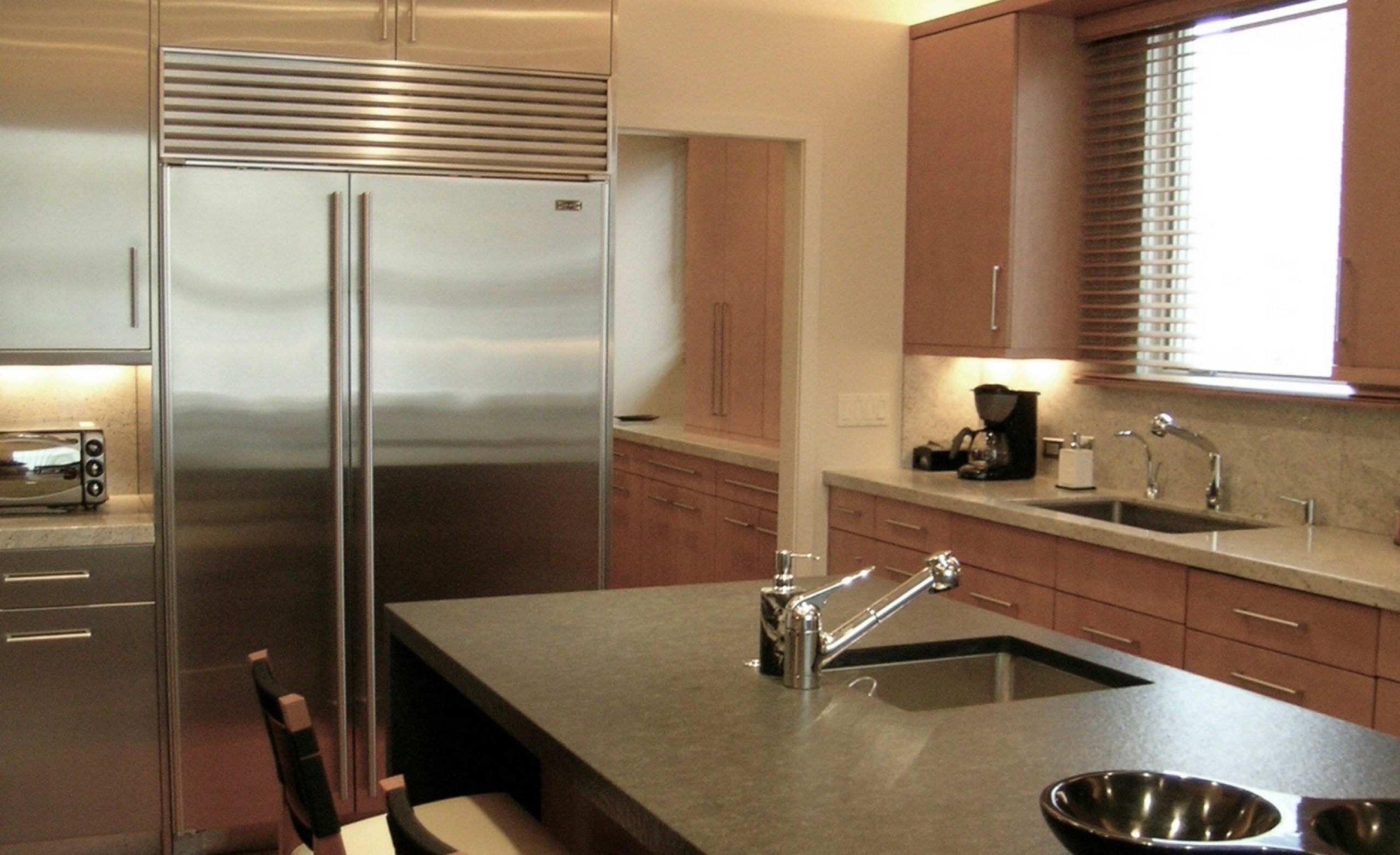 Kitchen with island and stainless appliances