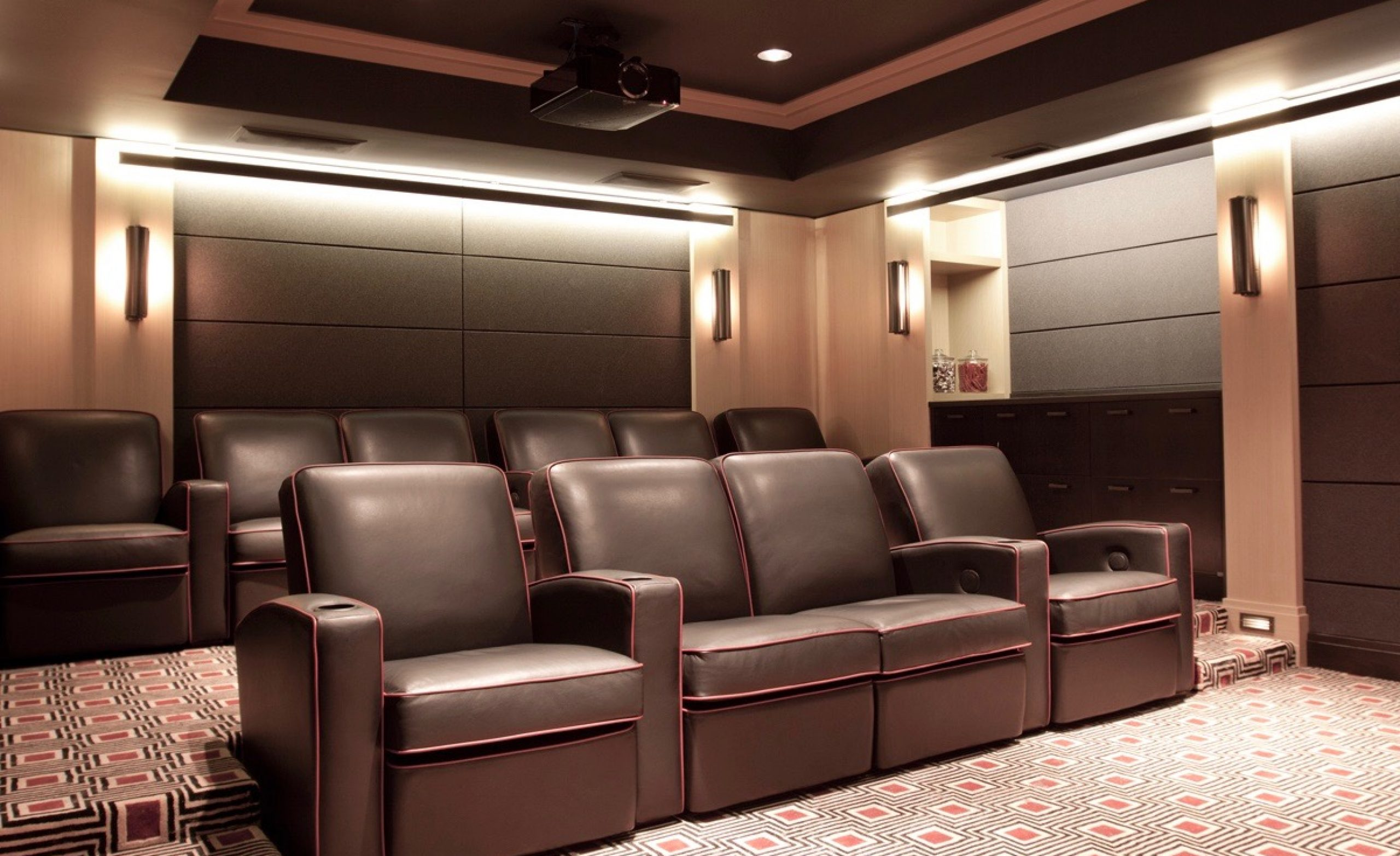 Home screening room with leather chairs